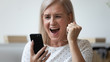 canvas print picture Close up excited older woman shouting, using phone, celebrating success