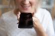 canvas print picture Close up mature woman holding phone, recording voice message