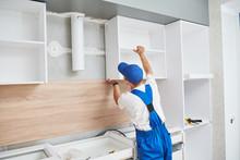 Kitchen Installation. Worker A...