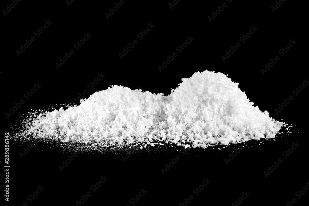Fotografía Pile of white snow isolated on black background