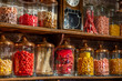 Leinwanddruck Bild - Old candy store. Colorful candies in jars. Old fashioned retro style