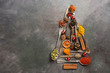 Leinwanddruck Bild - Various spices in spoons in the shape of a Christmas tree on a dark rustic background. Top view, flat lay, copy space.