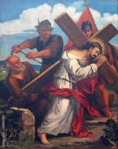 Fototapeta 5th Stations of the Cross, Simon of Cyrene carries the cross, church of St