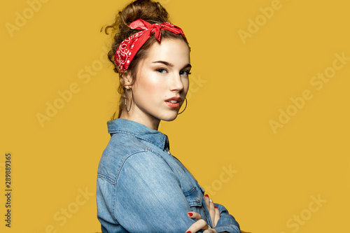 Fotografie, Obraz  Portrait of stunning young woman posing in profile on yellow background
