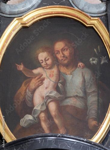 Fototapeta Saint Joseph with child Jesus, altarpiece in the church of St