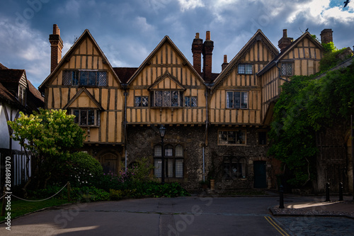 Timber framed building by Winchester Cathedral Wallpaper Mural