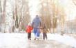 Leinwanddruck Bild Children play outside in the winter. Snow games on street.