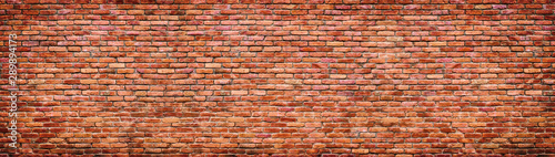 Poster Brick wall Vintage brick wall texture. Panoramic background of old stone.