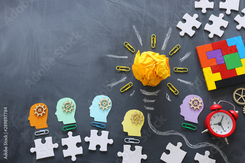 Obraz Education concept image. Creative idea and innovation. Crumpled paper as lightbulb metaphor over blackboard - fototapety do salonu