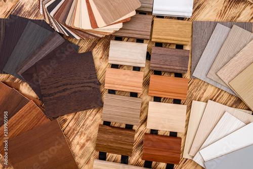 Fototapeta Plywood sampler in fan at wooden desk close up obraz na płótnie