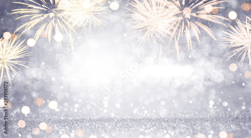 Fotografia  New Year Abstract background holiday, Gold and silver Fireworks and bokeh, copy space