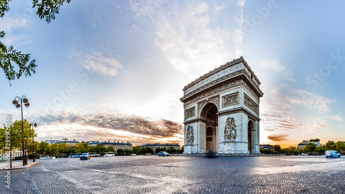 Paris Triumphal Arch the Arc de Triomphe de l'Etoile at the western end of the Champs-Elysees at the centre of Place Charles de Gaulle, France. Early morning with nice sunrise light - 289909368