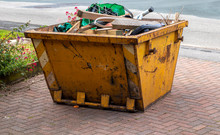 An Open Topped Skip Awaiting Collection