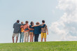 canvas print picture - selective focus of multicultural kids standing and hugging in park
