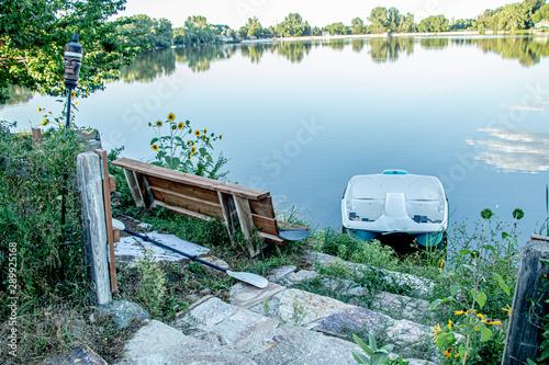 Colorado village lake with boats and daisies Canvas Print