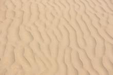 Wind Made Sand Pattern In Beach.