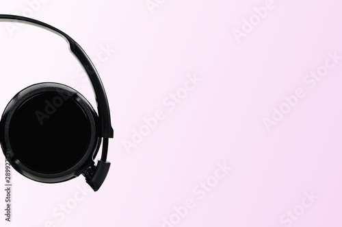 Black headphones on a pastel pink background. The concept of creating and listening to music. Comfortable headphones for listening to music. Creating sounds and listening to the foundations. - 289927751