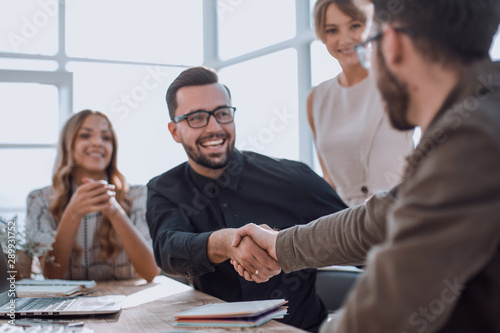background image of the handshake of business partners in the office - 289931752