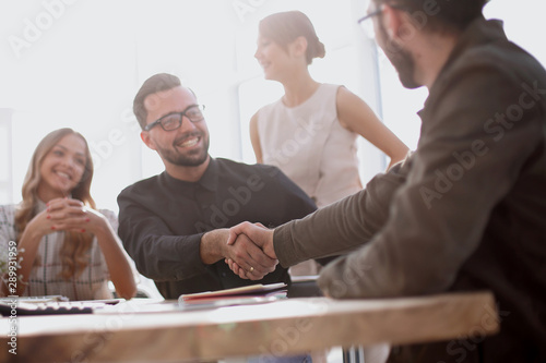 background image of the handshake of business partners in the office Canvas-taulu