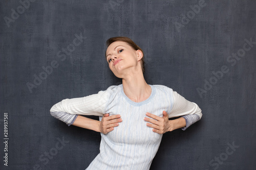 Shot of comic flirty woman imitating sexy photo pose Canvas Print