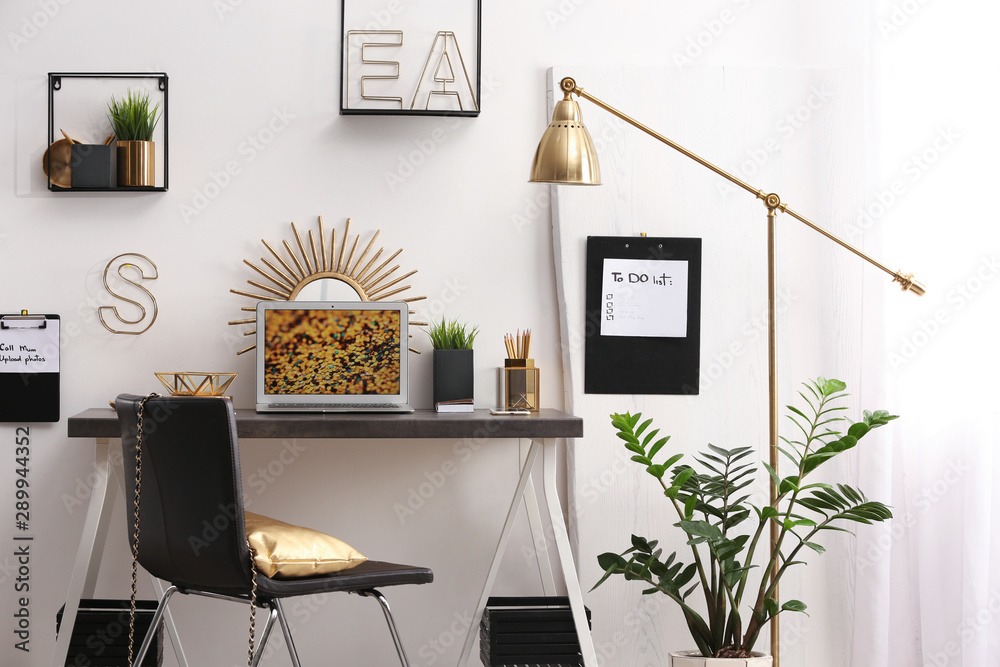 Fototapety, obrazy: Modern workplace with laptop and golden decor on desk near wall. Stylish interior design