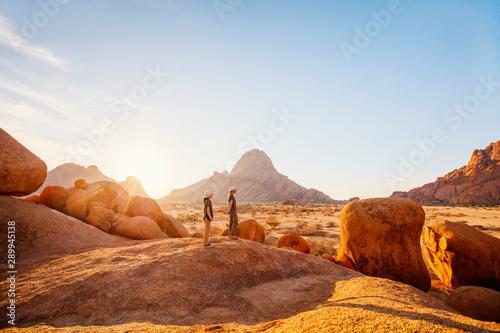 Obraz na plátne  Kids hiking in Spitzkoppe Namibia