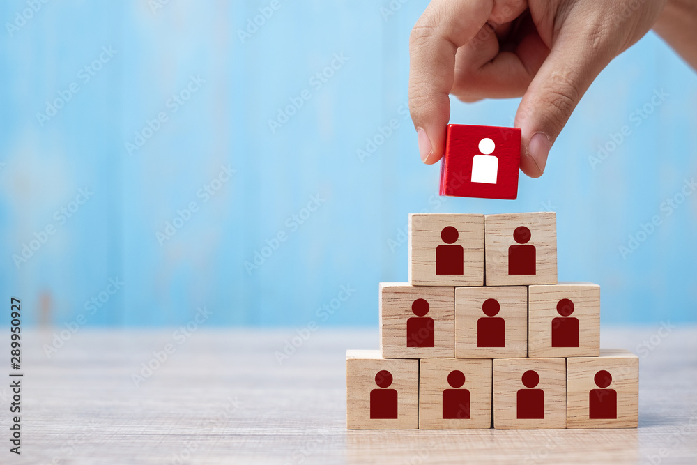 Fototapety, obrazy: Business man hand placing or pulling Red wooden block with white person icon on the building. People, Business, Human resource management, Recruitment, Teamwork, strategy and leadership Concepts