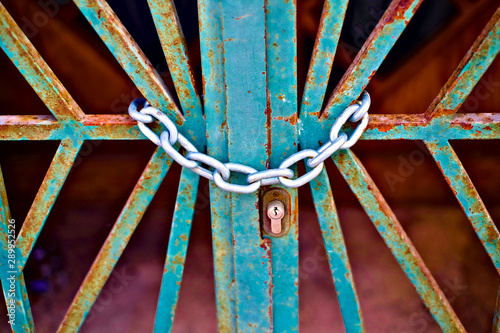 Chained and locked gate entrance, allegory of creative block. Wallpaper Mural
