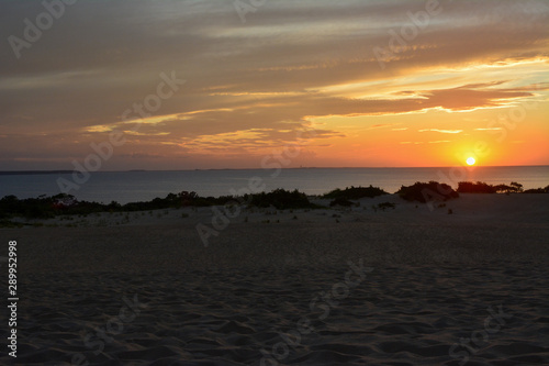 Sunset over the sound as seen from the top of the sand dunes in Jockeys Ridge State Park on the Outer Banks