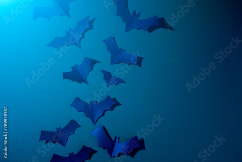 Photo sur Toile Animaux geometriques Halloween photo of blue paper bats flying up on dark blue background.