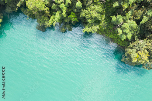Foto auf AluDibond Reef grun Sun Moon Lake in aerial with forest near the water
