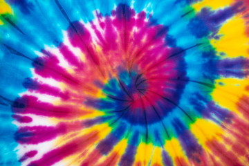 Tie dye rainbow color spiral abstract pattern background . hippie and reggae style .