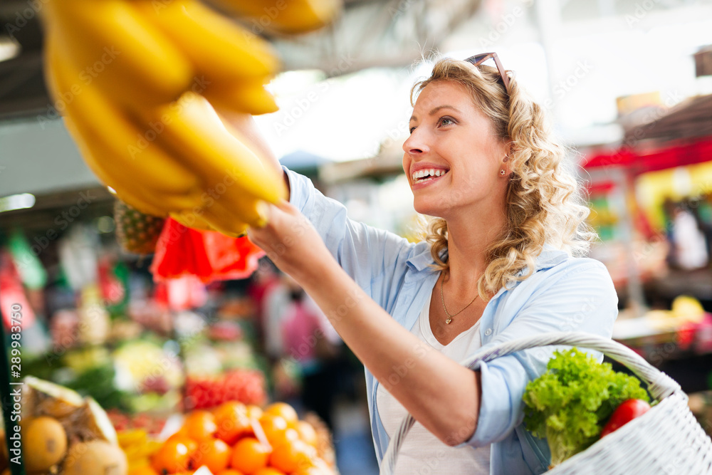 Fototapety, obrazy: Beautiful women shopping vegetables and fruits on the market
