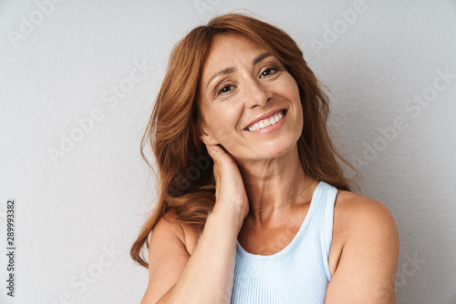 Obraz Portrait of an attractive middle aged woman - fototapety do salonu