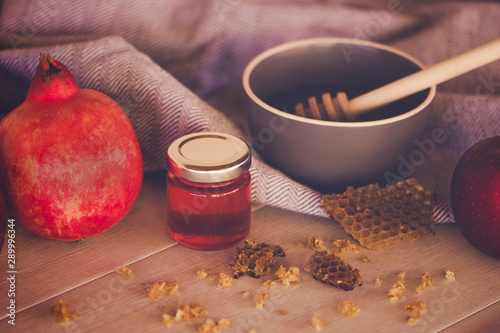 Jewish National Holiday. Rosh Hashana with honey, apple and pomegranate on wooden table. - 289996344