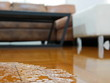 Leinwandbild Motiv Close up of water flooding on living room parquet floor in a house - damage caused by water leakage