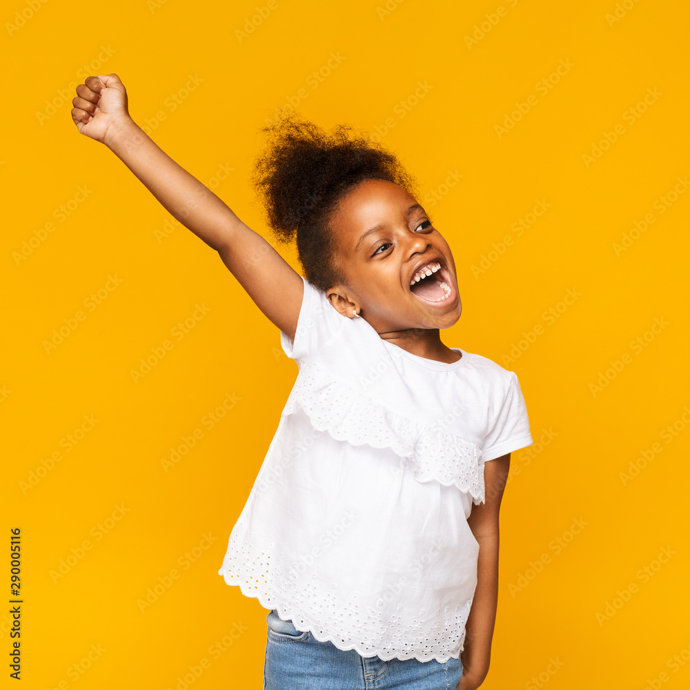 Fototapety, obrazy: Cute african toddler girl shouting hooray on orange background