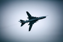 Military Jet Fighter Flying In The Cloudy Sky
