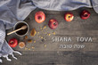 canvas print picture Jewish National Holiday. Rosh Hashana with honey, apple and pomegranate on wooden table. Text: SHANA TOVA