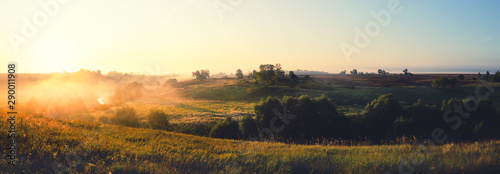 Garden Poster Beautiful morning Foggy summer panoramic landscape with green hills,distant woods and river