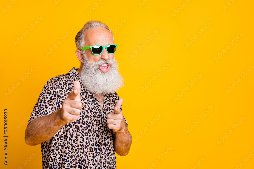 Fototapeta Portrait of funky old bearded man in eyeglasses eyewear feel cool crazy point at you wearing leopard shirt isolated over yellow background