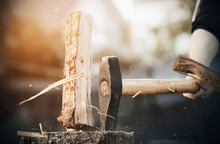 A Powerful Sharp Axe Cuts A Log Into Pieces, From Which Small And Large Splinters Fly In All Directions.