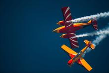 Two Aerobatic Planes Close Flight
