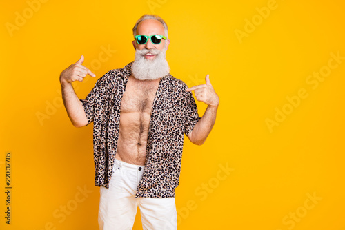 Photo of cheerful nice old man pointing at himself to show you his handsomeness Fototapeta