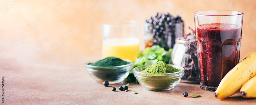 Fototapety, obrazy: Healthy eating, alkaline diet, vegan concept. Blueberries, bilberry, barley grass, spirulina powder, orange juice, dulse, cilantro on marble background. Ingredients for heavy metals detox smoothie.