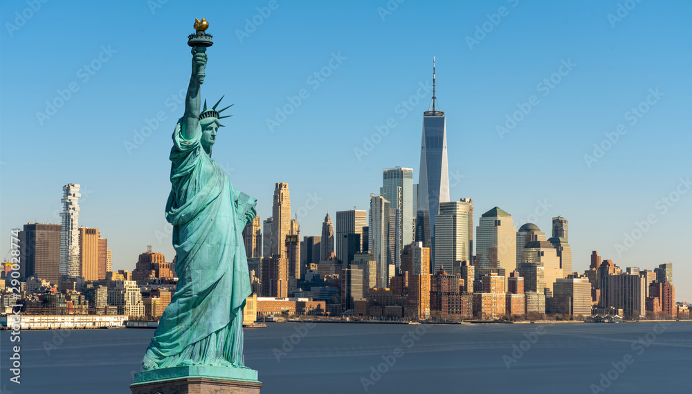 Fototapeta The Statue of Liberty over Scene of New York cityscape river side which location is lower manhattan which can see One world trade conter, United state of America, USA, Taking from New Jersey skyline
