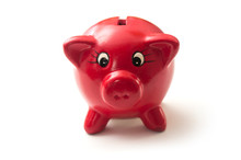 Closeup Of Red Piggy Bank On White Background