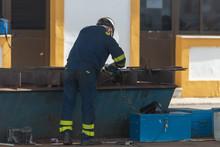 Worker Working On Ship Repairing Yard