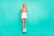 canvas print picture - Full length body size view of her she nice-looking attractive sportive cheery slender straight-haired model having fun jumping up isolated over bright vivid shine green blue turquoise background