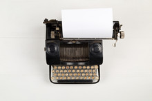Vintage Retro Typewriter With Sheet Of Paper On White Table Background Top View Flat Lay From Above With Copy Space - Journalism Or Writer Concept